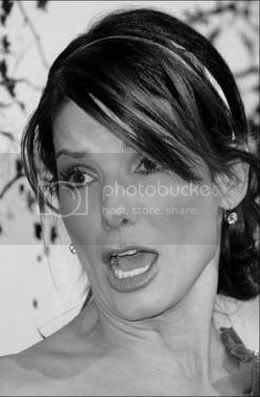 http://i573.photobucket.com/albums/ss177/believe_my/Sandra-Bullock-1.jpg?t=1251838873